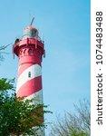 lighthouse west schouwen of...   Shutterstock . vector #1074483488