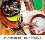 dirty dishes in the sink | Shutterstock . vector #1074495926