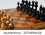 initial position of chessmen on ...   Shutterstock . vector #1074496628