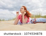 young woman on sand to...   Shutterstock . vector #1074534878
