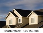 the gabled roofline of a new... | Shutterstock . vector #107453708