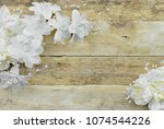 white and ivory silk flowers on ... | Shutterstock . vector #1074544226