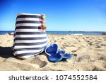 beach bag  sunglasses on the... | Shutterstock . vector #1074552584