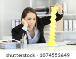 bored executive wasting time... | Shutterstock . vector #1074553649