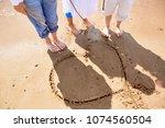 three barefoot girls standing...   Shutterstock . vector #1074560504