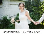 beautiful young bride.the...   Shutterstock . vector #1074574724