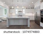 elegant kitchen in new home.... | Shutterstock . vector #1074574883