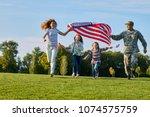 shot of patriotic family...   Shutterstock . vector #1074575759