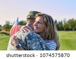 american soldier is hugging... | Shutterstock . vector #1074575870