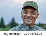 close up face of a smiling... | Shutterstock . vector #1074575906