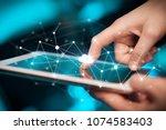 female hands touching tablet... | Shutterstock . vector #1074583403
