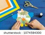 child makes bird from cd.... | Shutterstock . vector #1074584300
