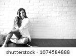 beautiful girl artist at work...   Shutterstock . vector #1074584888