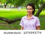 beautiful young woman outdoor...   Shutterstock . vector #1074593774