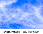 air clouds in the blue sky. | Shutterstock . vector #1074595334