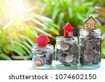 house model on coins saving for ... | Shutterstock . vector #1074602150
