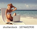 happy girl on the beach with a... | Shutterstock . vector #1074602930