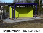 Outdoor Stage With Green Walls...