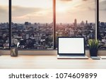 laptop on table in office room... | Shutterstock . vector #1074609899