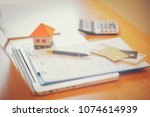 rental agreement document with... | Shutterstock . vector #1074614939