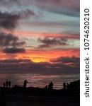sillohuette  people by ocean...   Shutterstock . vector #1074620210