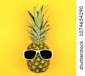 hipster pineapple with... | Shutterstock . vector #1074654290