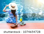 woman is sitting at the pool...   Shutterstock . vector #1074654728