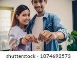 closeup asian young lover hand... | Shutterstock . vector #1074692573