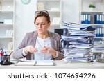 businesswoman very busy with... | Shutterstock . vector #1074694226