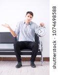 man nervously impatiently... | Shutterstock . vector #1074698588