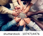 group of diverse hands holding... | Shutterstock . vector #1074714476