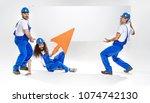 three workers posing on empty... | Shutterstock . vector #1074742130
