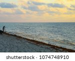 sunrise scene at tropical beach.   Shutterstock . vector #1074748910