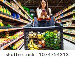 woman with smartphone in store. ... | Shutterstock . vector #1074754313