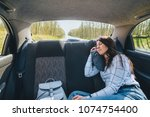 young woman sleeping in car on...   Shutterstock . vector #1074754400