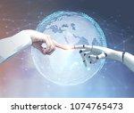 human and robot hands reaching... | Shutterstock . vector #1074765473