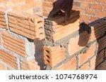 worker mason at construction... | Shutterstock . vector #1074768974