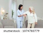 unpaid work. cheerful caregiver ... | Shutterstock . vector #1074783779