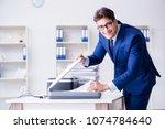 businessman making copies in... | Shutterstock . vector #1074784640