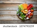 hummus and variety of vegetable ... | Shutterstock . vector #1074793259