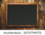 grunge rusty old frame on top... | Shutterstock . vector #1074794570