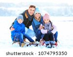 portrait of happy family with... | Shutterstock . vector #1074795350