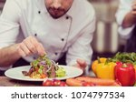 cook chef decorating garnishing ... | Shutterstock . vector #1074797534