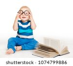 baby in glasses read book ... | Shutterstock . vector #1074799886