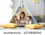 nanny and little children... | Shutterstock . vector #1074808340