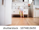 toddler boy in a dangerous... | Shutterstock . vector #1074813650