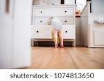 toddler boy in a dangerous... | Shutterstock . vector #1074813650