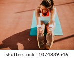 sporty young woman doing... | Shutterstock . vector #1074839546