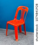 one red plastic chair on the... | Shutterstock . vector #1074841928