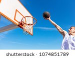 slam dunk. side view of young...   Shutterstock . vector #1074851789